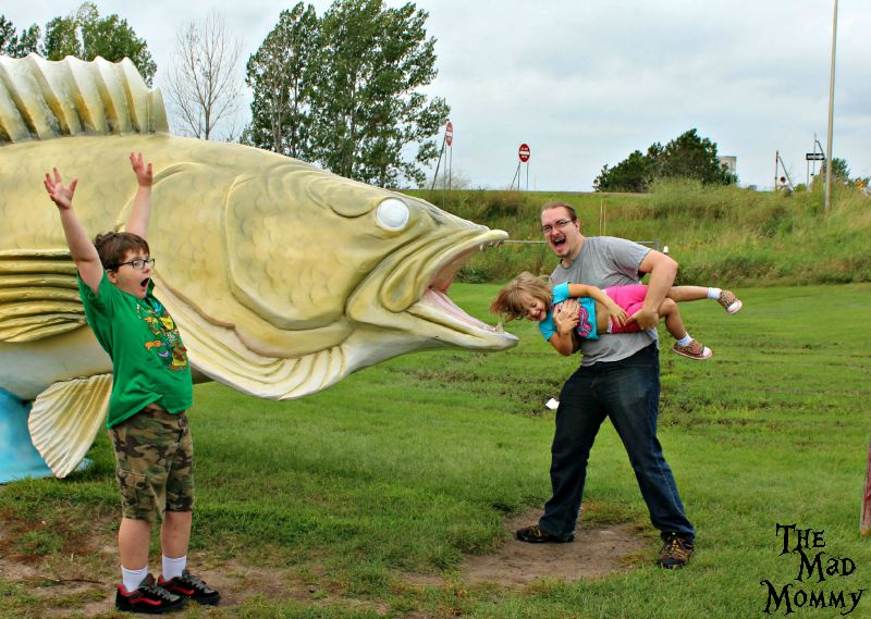 A real-life family photo with the World's Largest Walleye in Rush City!