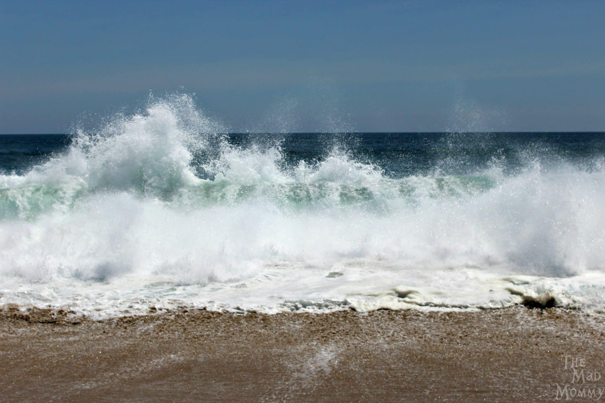 The waves seem to be alive with energy when they crash onto Newport Beach.