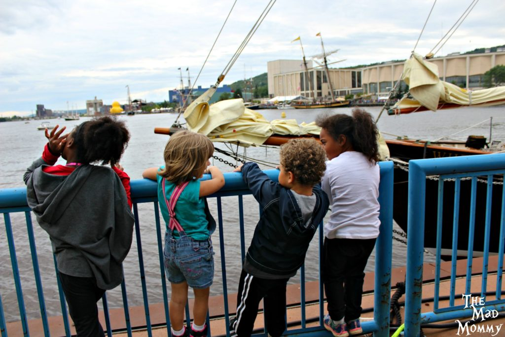 Kids watching all of the Tall Ships!