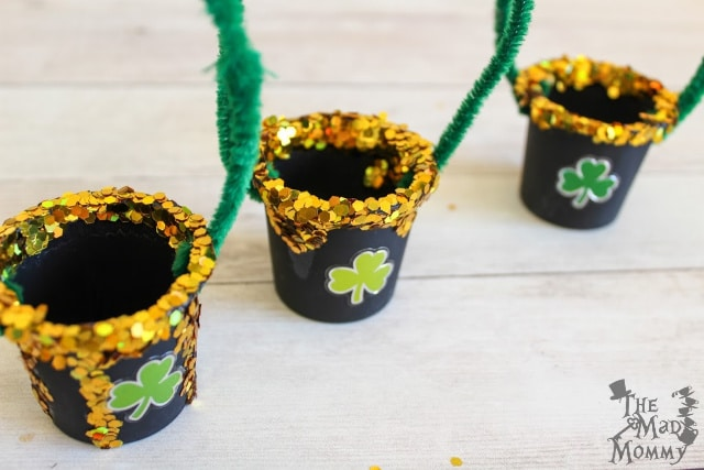 Assembling this k-cup craft idea for St. Patrick's Day.