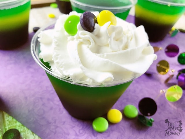 """Normally, you hear about people eating King Cake and """"finding the baby"""" on Fat Tuesday, but I decided to change it up a little bit. This Mardi Gras recipe is completely kid-friendly! (But, I won't judge you if you turn it into an adult only layered dessert. *wink wink*)"""